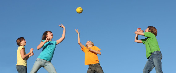 CN63Y3 active kids playing ball at summer camp