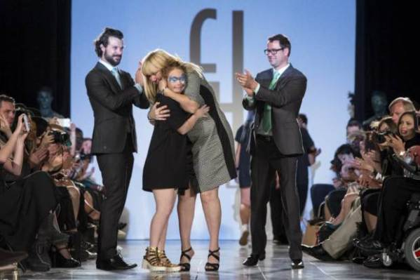 Madeline Stuart, an Australian model with Down Syndrome is embraced by her mother Rosanne Stuart as Designers Hendrik Vermeulen (L) and JD Meyer-Vermeulen (R) look on after presenting the Henndrik Vermeulen label during the FTL Moda presentation of the Spring/Summer 2016 collection during New York Fashion Week in Vanderbilt Hall at Grand Central Station, New York, September 13, 2015. FTL Moda presented a range of designers and partnered with the Christopher & Dana Reeve Foundation and Global Disability Inclusion. The show casted a diverse range of models, including models living with disabilities. REUTERS/Andrew Kelly TPX IMAGES OF THE DAY