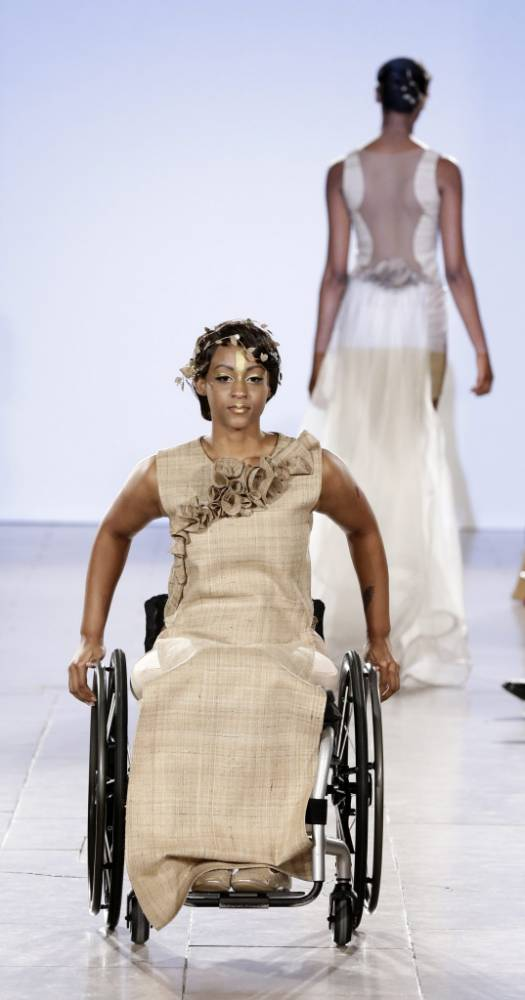 epa04929339 US wheelchair model Leslie Irby poses on the runway during the Spring 2016 collection by FTL Moda during New York Fashion Week in New York, New York, USA, 13 September 2015. The Spring 2016 collections are presented from 10 to 17 September. EPA/JASON SZENES