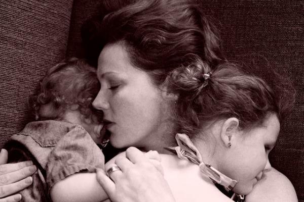 Italian mother hugging two children closeup b&wMonkey Mash ButtonPhoto URL : http://www.flickr.com/photos/monkeymashbutton/5900944674/