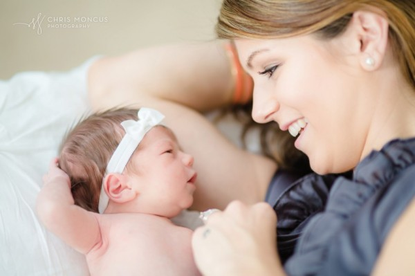 11-New-Mother-Snuggling-with-Newborn-Baby-820x546