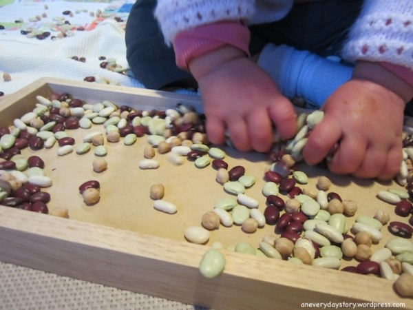 montessori-sensory-activities-for-toddlers-spooning-dried-beans-an-everyday-story-4-600x450